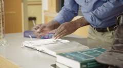 Science Teacher Writing and Packing Up HD Stock Footage