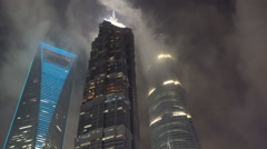 Night view of illuminated skyscrapers in central Shanghai, urban China Stock Footage