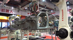 Japanese car welding robot on display at technology trade show in China Stock Footage
