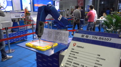 Writing robot arm on display at a technology fair in Shanghai - stock footage