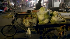 Beijing in dense smog. Cargo bicycle in the Hutong street market at night - stock footage