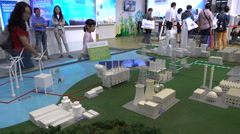 China clean energy, scale model, trade show, windmills, solar panels, nuclear - stock footage