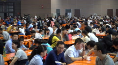 Business people, visitors of trade show eat lunch in big restaurant, China Stock Footage