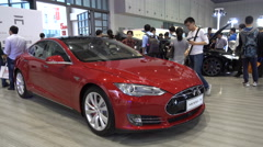 Tesla S car model on display at technology trade show in Shanghai, China - stock footage