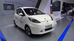 Small Chinese electric vehicle on display at trade show Shanghai - stock footage
