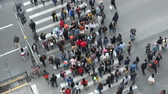 Time lapse pedestrians crossing a busy zebra, shopping street Shanghai China Stock Footage