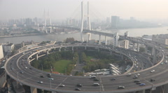 Day time lapse of traffic driving over Nanpu bridge in Shanghai, China Stock Footage