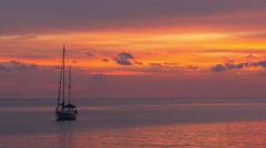 Red orange sunset boat ride beach view panorama 4k phuket thailand Stock Footage