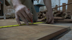Hands of Chinese carpenter measuring, using pencil, furniture workshop Stock Footage