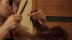 Hairdresser making a hairstyle on womans had 3 Stock Footage