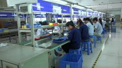 Chinese factory workers at the assembly line of electronics factory Stock Footage
