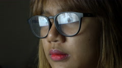 Asian Woman reading website reflected in glasses 4k UHD (3840x2160) - stock footage