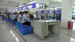 Factory workers in China Stock Footage