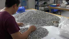 Chinese factory worker checks buttons at packing department Stock Footage
