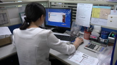 Chinese office worker takes orders from clients online, sales department Stock Footage