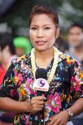Television reporter woman in Thailand - stock photo