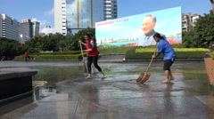 Two women clear water, leaking economy, slowdown, Deng Xiaoping, China, symbolic Stock Footage