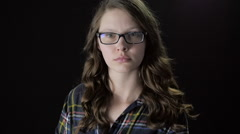 Close-Up Female with Glasses Raises Assault Rifle in Slow Motion Stock Footage