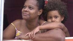 Mother and son, Rio de Janeiro, Santa Marta favela, Brazil Stock Footage