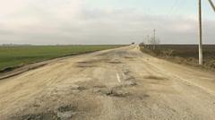 Rural destroyed asphalt road in calm countryside. Springtime landscape. Stock Footage