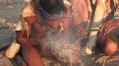 Bushmen making a fire in the traditional way Stock Footage