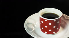 Cup of hot coffee with platter and spoon Stock Footage