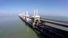 Aerial flying low and parallel west side Oosterscheldekering Delta Works 4k Stock Footage