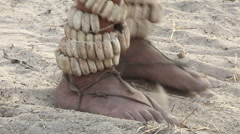 Close-up of Bushmen feet dancing rattles Stock Footage
