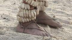 Close-up of Bushmen feet dancing rattles - stock footage