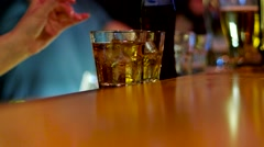 The girl bartender gives the visitor a double scotch whiskey with cola. Stock Footage