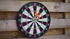 Person playing darts outdoors, enjoying hobby, fun activity. Entertaining game Stock Footage