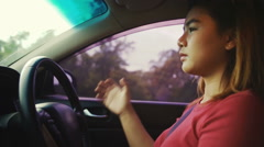 Young woman driving car slowmotion Stock Footage
