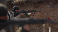Two soldiers shooting with machine guns Stock Footage