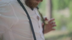 Man with a beard wearing a white shirt and suspenders Stock Footage