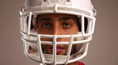 Close up of player of American Football with USA flag on background Stock Footage