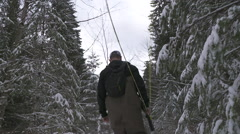 Man walking with fly fishing rod Stock Footage