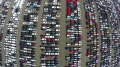 Aerial top down bird view new car storage parking lot imported new vehicles 4k Stock Footage