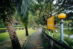 Walkway along Zhongshan Park, in the Xinyi District, Taipei, Taiwan. Stock Photos