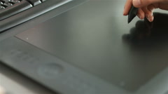 Closeup of hand working on graphic tablet Stock Footage