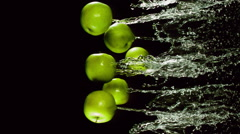 Green apple with splashes of water Stock Footage