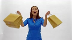 Pretty woman in blue dress posing with eco frendly paper bags Stock Footage