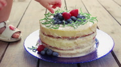 Child's hand takes berries Stock Footage