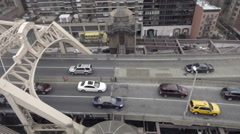 Overhead view of cars driving on Queensboro Bridge moving tram slow motion NYC Stock Footage