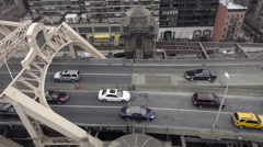 Cars crossing Queensboro Bridge from high tracking view on tram in NYC Stock Footage