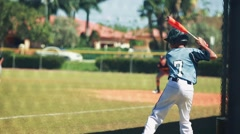 Slow motion of batter practicing before his turn during baseball game Stock Footage