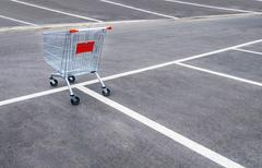 Empty shopping carts on a empty parking lot - stock photo