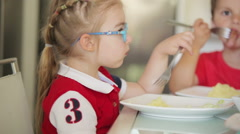 Children dine in a good mood - stock footage