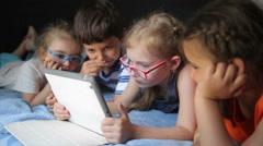 Children look cartoon on the tablet - stock footage