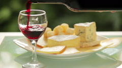 Red wine is poured into a glass Stock Footage