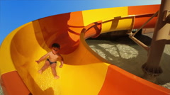 Children ride the roller coaster in the pool Stock Footage